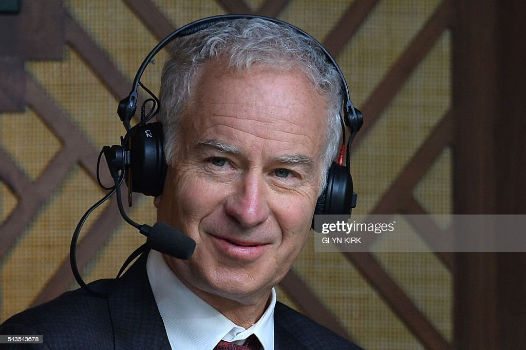 Commentator and tennis coach John McEnroe sits in the press booth on centre court to watch Serbia's Novak Djokovic play against France's Adrian Mannarino during their men's singles second round match on the third day of the 2016 Wimbledon Championships at The All England Lawn Tennis Club in Wimbledon, southwest London, on June 29, 2016. / AFP / GLYN