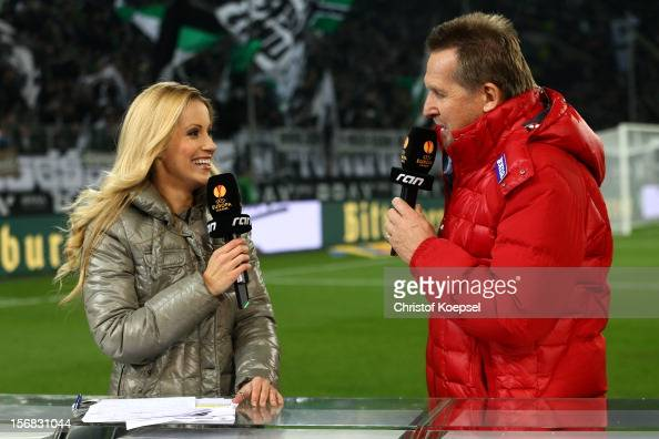 Commentator Andrea Kaiser of ran television channel and expert bernd Schuster talk prior to the UEFA Europa League group C match between Borussia...
