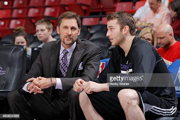 Commentator Brent Barry talks to Nik Stauskas of the Sacramento Kings prior to the game against the Houston Rockets on December 11 2014 at Sleep...