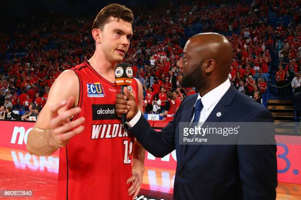 NBL commentator Corey Williams interviews Angus Brandt of the Wildcats following the round two NBL match between the Perth Wildcats and the Illawarra...