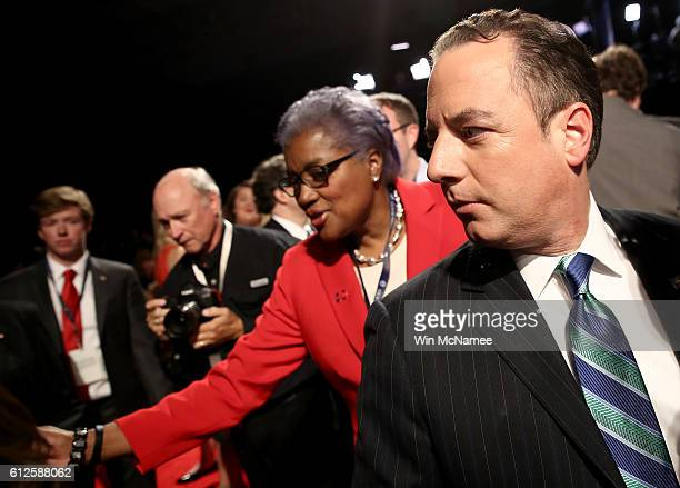 CNN commentator Donna Brazile and Reince Priebus chairman of the Republican National Committee arrive for the Vice Presidential Debate between...