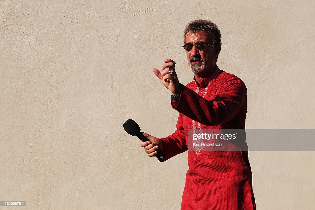 BBC commentator Eddie Jordan wears a shirt signed by all the F1 drivers before the Abu Dhabi Formula One Grand Prix at the Yas Marina Circuit on...