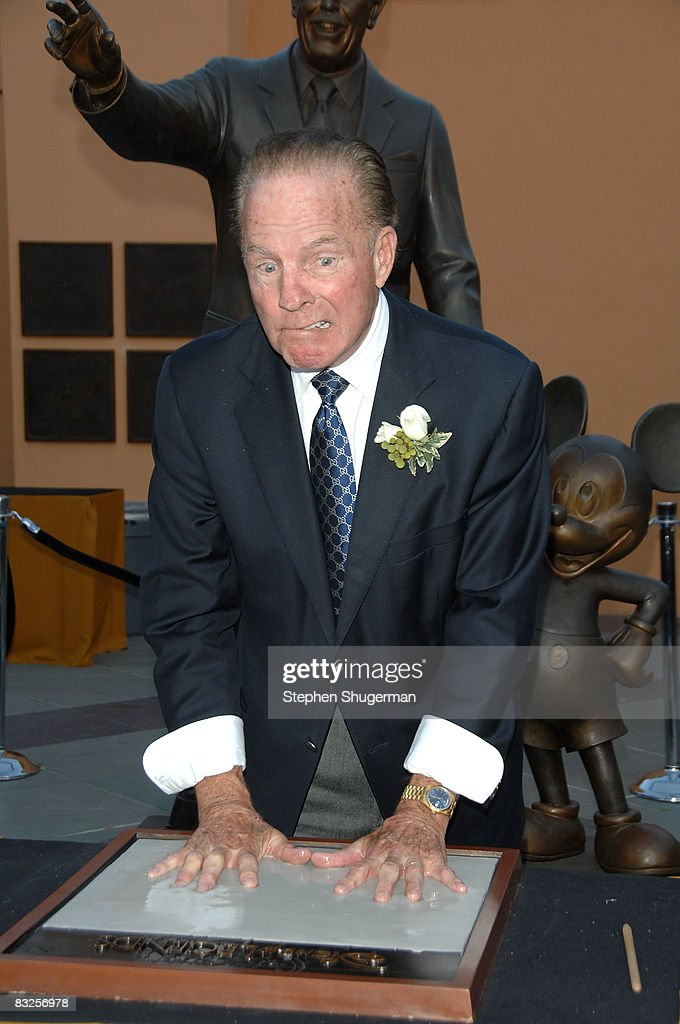 TV commentator Frank Gifford makes a hand print at the 2008 Disney Legends Ceremony at the Walt Disney Studios on October 13, 2008 in Burbank, California.