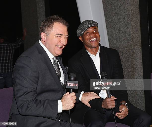 TSN commentator Gino Reda interviews Cuba Gooding Jr during the red carpet festivities prior to the induction ceremony at the Hockey Hall of Fame on...