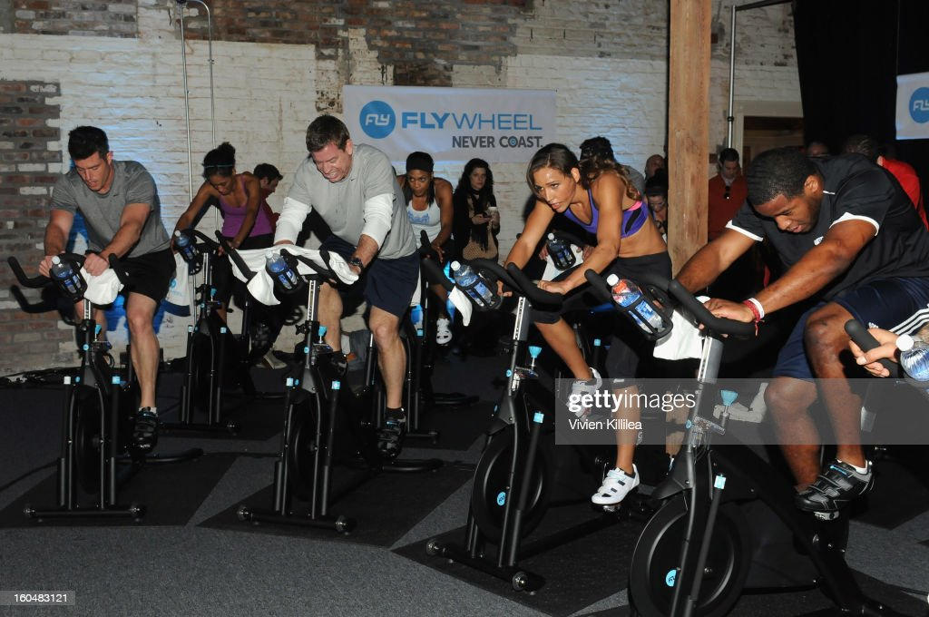 Commentator Jesse Palmer, former NFL player Troy Aikman, olympian Lolo Jones and NFL player Alfred Morris attend The Flywheel Challenge at the NFL House hosted by Shannon Sharpe at The Chicory on February 1, 2013 in New Orleans, Louisiana.