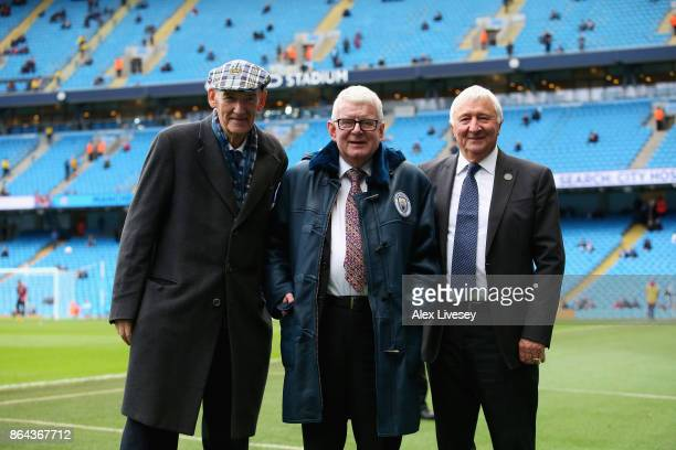 Commentator John Motson is presented with a coat by Manchester City life president Bernard Halford and former player Mike Summerbee prior to the...