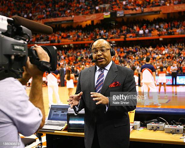 ESPN commentator Mike Tirico talks on camera before the game between the Syracuse Orange and the Florida Gators at the Carrier Dome on December 2...