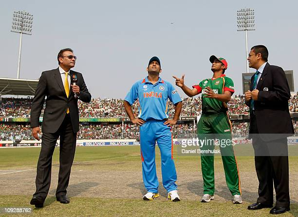 Commentator Ravi Shastri and Captain MS Dhoni of India look on as Captain Shakib Al Hasan tosses the match coin during the opening game of the ICC...