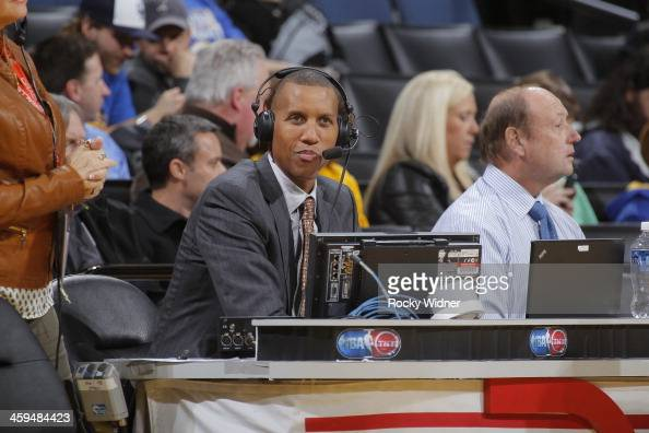 NBA commentator Reggie Miller watches the San Antonio Spurs face off against the Golden State Warriors on December 19 2013 at Oracle Arena in Oakland...