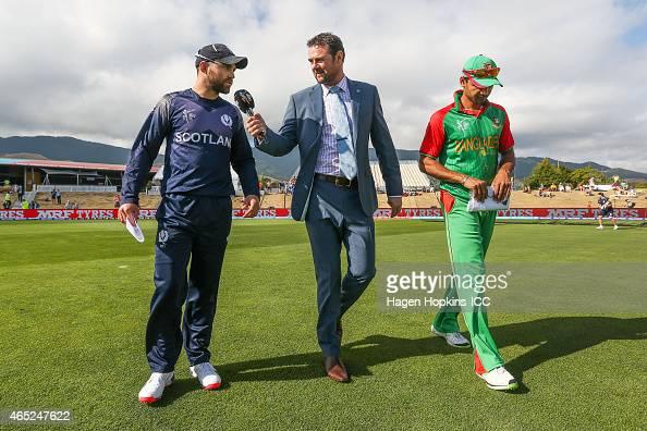 Commentator Simon Doull talks to Preston Mommsen of Scotland while Mashrafe Mortaza of Bangladesh looks on during the 2015 ICC Cricket World Cup...