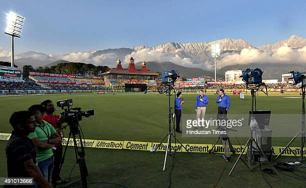 TV commentators during a live chat before the 1st T20 cricket match between India and South Africa at Himachal Pradesh Cricket Association Stadium at...