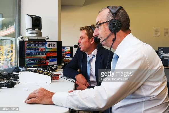 Commentators Shane Warne and David Lloyd at work during the 2015 ICC Cricket World Cup match between England and Sri Lanka at Wellington Regional...