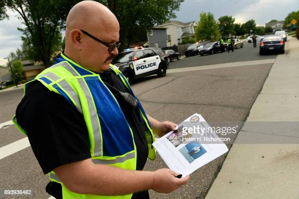 Commerce police officer gets ready to hand out posters with the face of missing 10 year old Kiaya Campbell on June 8 2017 in Thornton Colorado...