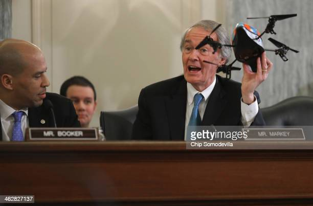 Commerce Science and Transportation Committee member Sen Edward Markey holds up a small fourbladed remote controlled helicopter during a hearing...