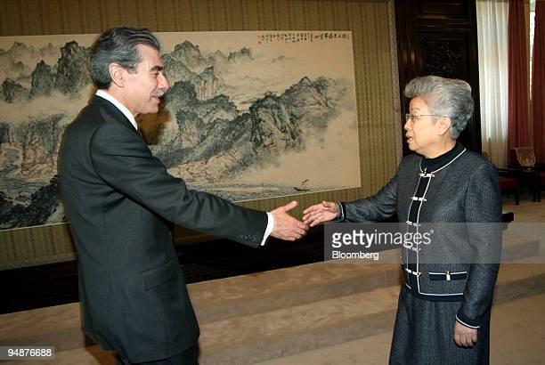 S Commerce Secretary Carlos Gutierrez left shakes hands with Chinese Vice Premier Wu Yi right at the Zhong Nan Hai compound in Beijing June 4 2005...