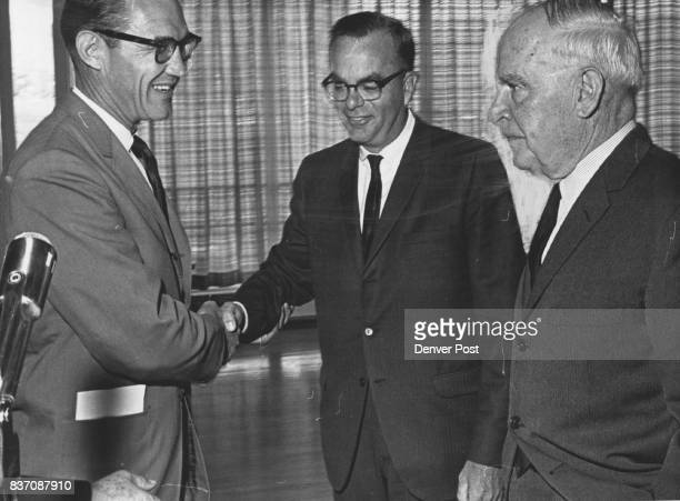 Commerce Secretary Luther Hodges Right Sees Both Sides US Rep Donald Brotzman RColo left shakes hands with State Sen Roy McVicker DWheat Ridge Two...