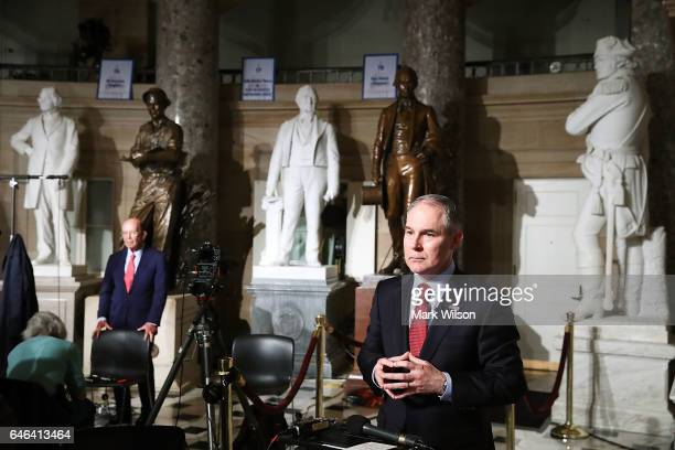 Commerce Secretary Wilbur Ross and EPA Administrator Scott Pruitt prepare to do television interviews in Statuary Hall at the US Capitol before...