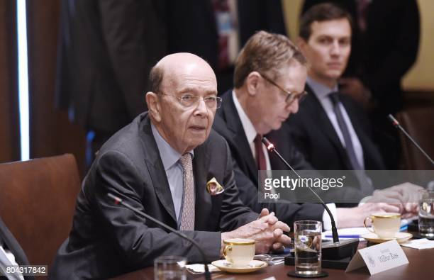 Commerce Secretary Wilbur Ross speaks during a meeting between US President Donald Trump and South Korean President Moon Jaein in the Cabinet Room of...