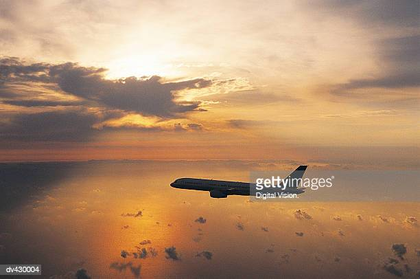 Commercial Aeroplane Flying Above the Sea at Dusk