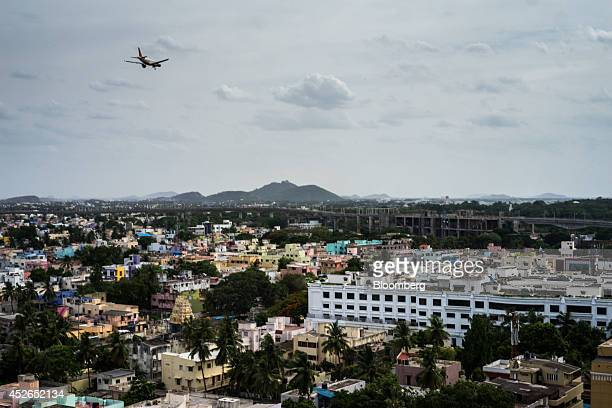 A commercial airliner flies over the city in Chennai Tamil Nadu India on Monday July 21 2014 Optimism about a revival in Asias thirdlargest economy...