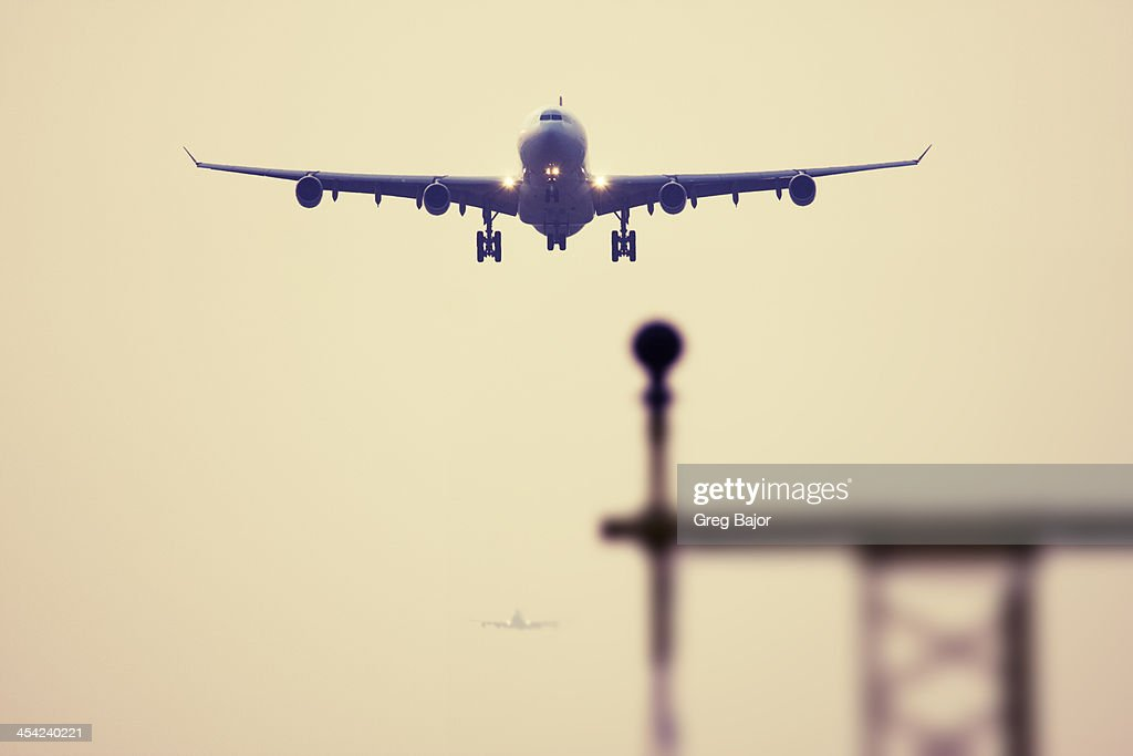 Commercial airliners landing : Stock Photo
