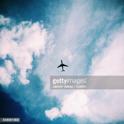 Commercial Airplane Amidst White Clouds
