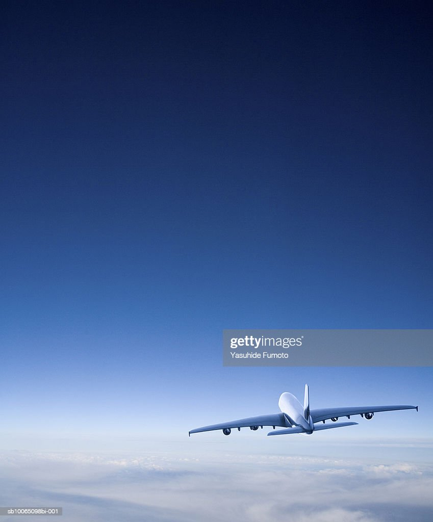 Commercial airplane in flight, rear view