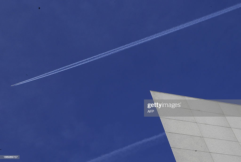A commercial airplane leaves contrails in the sky over Vienna on April 8, 2013.