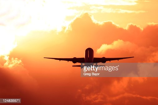 Commercial airplane taking off at dusk
