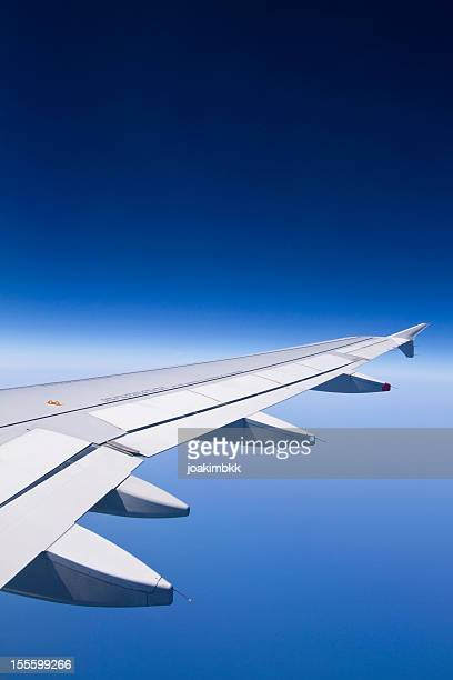 Commercial airplane wing at high altitude