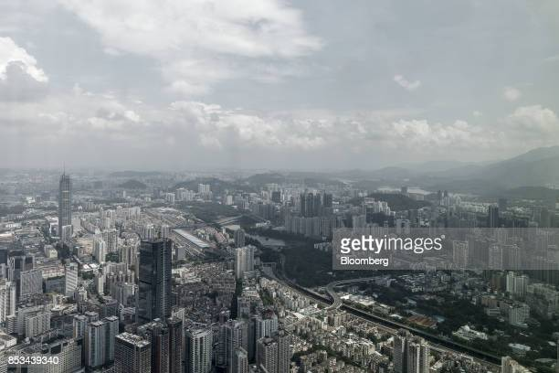 Commercial and residential buildings are seen from the observation deck of the KK100 tower in Shenzhen China on Wednesday Sept 20 2017 China is on a...
