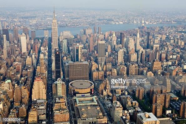 Commercial and residential buildings including the Empire State Building left and Madison Square Garden center stand in midtown Manhattan in this...