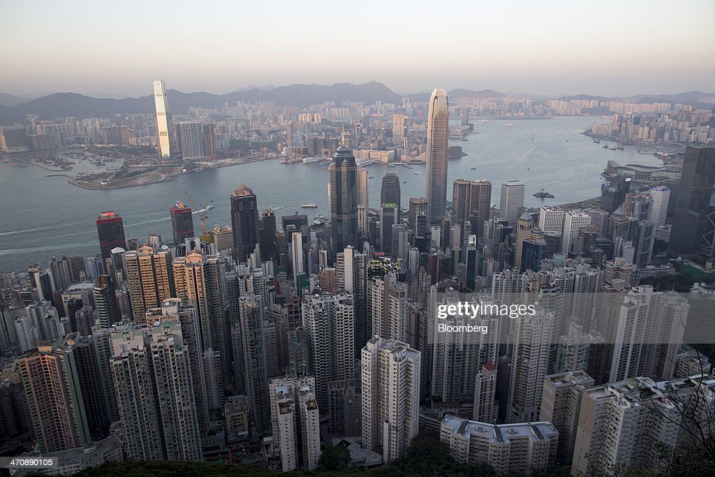 Commercial and residential buildings sit in Hong Kong China on Thursday Feb 20 2014 Hong Kong is scheduled to release fourth quarter gross domestic...