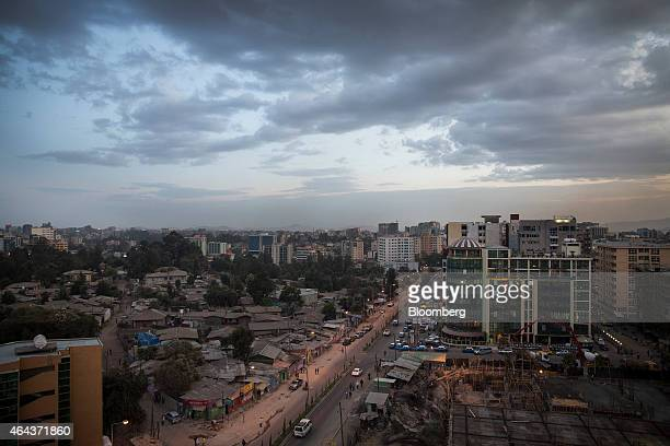 Commercial and residential buildings stand along a highway illuminated at dusk in Addis Ababa Ethiopia on Tuesday Feb 24 2015 Ethiopia's arabica...