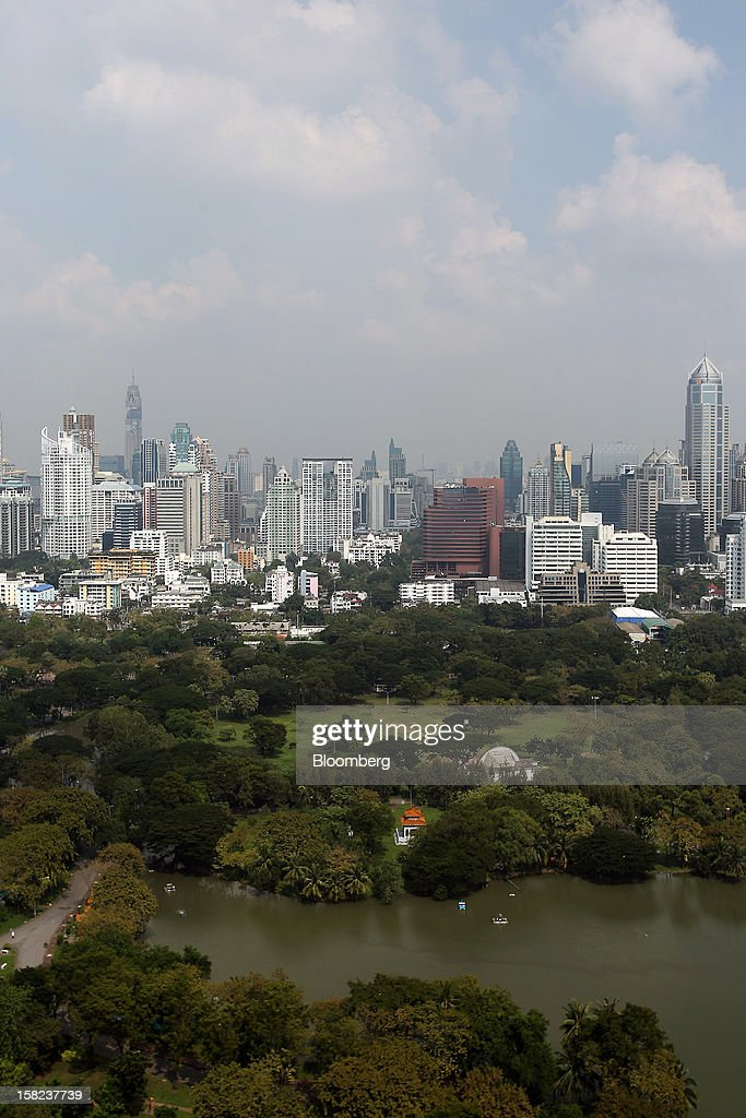 Commercial and residential buildings stand behind Lumpini Park in Bangkok, Thailand, on Tuesday, Dec. 11, 2012. The Crown Property Bureau owns about 41,300 rai (66 square kilometers) of land across the country, about a fifth of which is in Bangkok, according to Aviruth Wongbuddhapitak, an adviser to the CPB who sits on the board of two of its subsidiaries. Photographer: Dario Pignatelli/Bloomberg via Getty Images