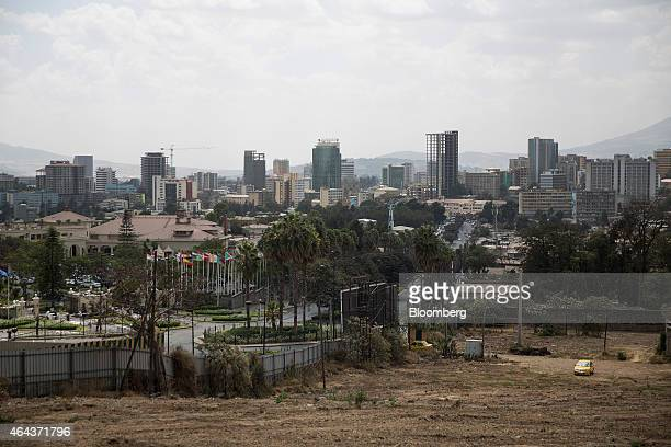 Commercial and residential buildings stand beyond waste ground on the city skyline in Addis Ababa Ethiopia on Tuesday Feb 24 2015 Ethiopia's arabica...