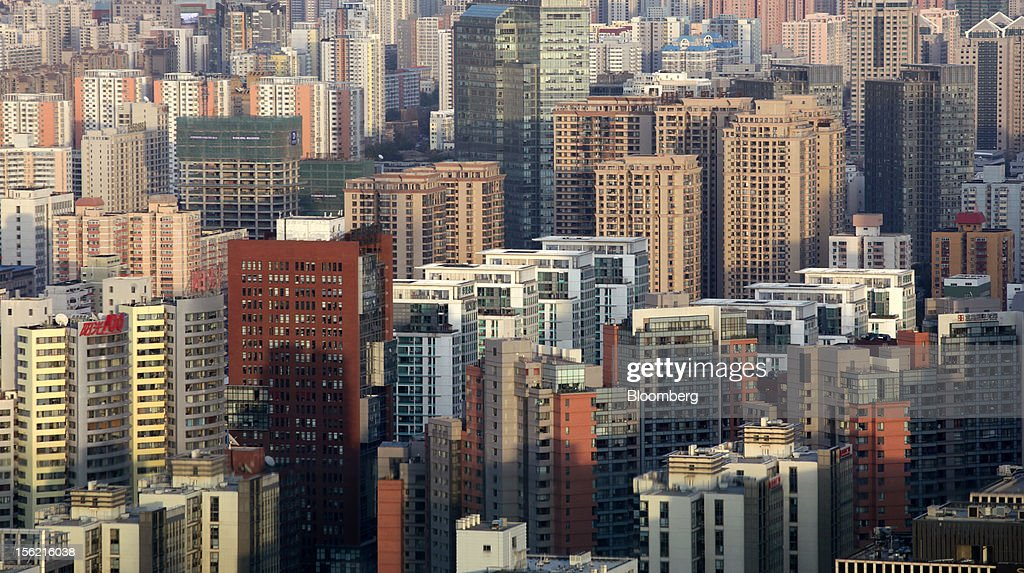 Commercial and residential buildings stand in Beijing, China, on Sunday, Nov. 11, 2012. China's retail sales exceeded forecasts and inflation unexpectedly cooled to the slowest pace in 33 months, signaling the government is boosting growth without driving a rebound in prices. Photographer: Tomohiro Ohsumi/Bloomberg via Getty Images