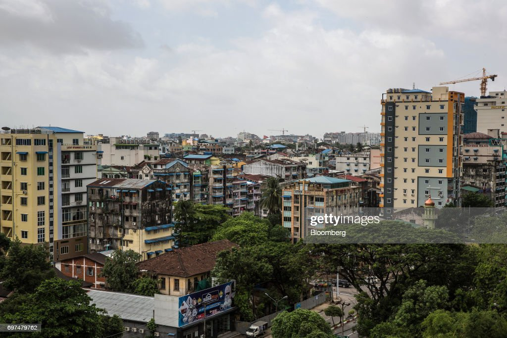 Commercial and residential buildings stand in Yangon, Myanmar, on Monday, June 12, 2017. When the country opened to the outside world in 2011 after decades of military rule, the former British colony held promise as one of the worlds hottest tourist destinations, a last frontier for adventure travel.But it hasn't worked out that way. A construction glut has flooded Myanmar with unused hotel rooms, and poorly regulated building has damaged national treasures like the archaeological site of Bagan. Photographer: Taylor Weidman/Bloomberg via Getty Images