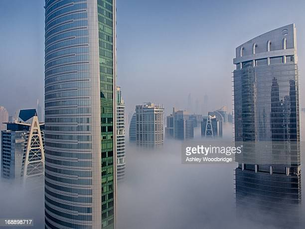 CONTENT] Commercial and Residential High rises /skyscrapers in Dubai reaching through the fog on an early January morning