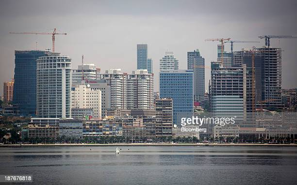 Commercial and residential properties stand on the skyline in the business district in Luanda Angola on Friday Nov 8 2013 Angola the largest crude...