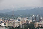 Commercial and residential property sits on the city skyline in front of the Almaty Television Tower in Almaty Kazakhstan on Friday June 26 2015...
