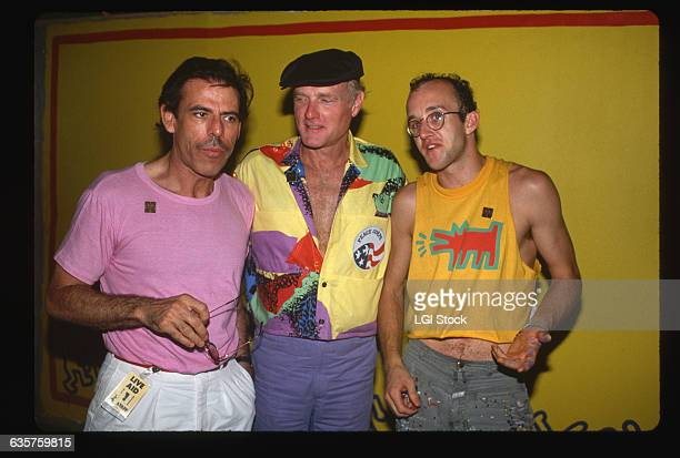 Commercial artist Peter Max stands with artist and designer Keith Haring and Beach Boy frontman Mike Love