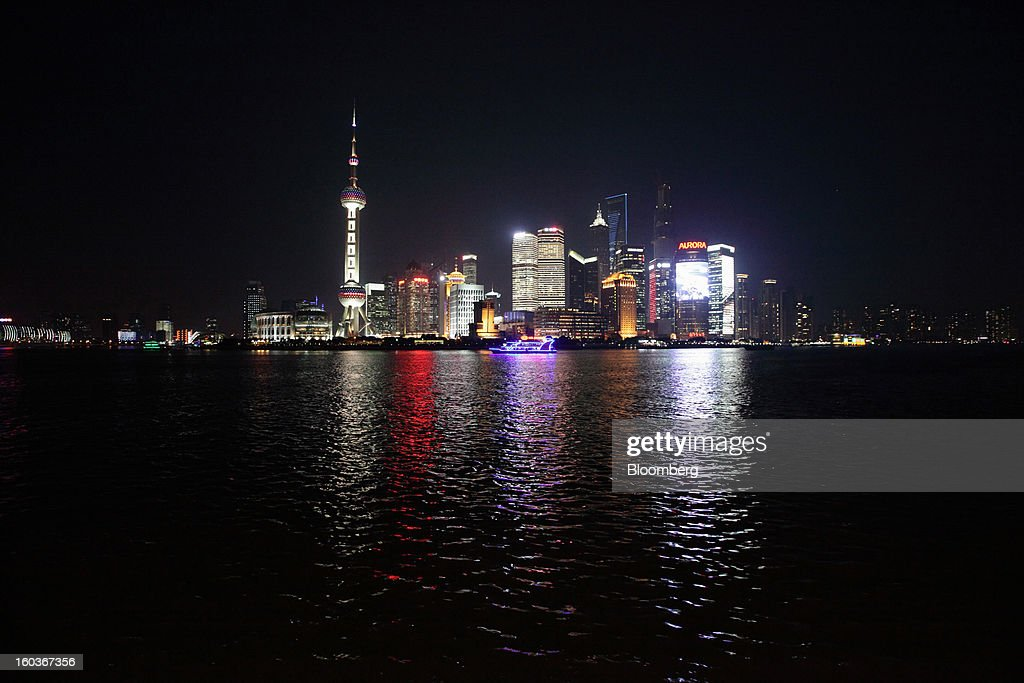 Commercial buildings in the Pudong area are seen from the Bund at night in Shanghai, China, on Monday, Jan. 28, 2013. China's economic growth accelerated for the first time in two years as government efforts to revive demand drove a rebound in industrial output, retail sales and the housing market. Photographer: Tomohiro Ohsumi/Bloomberg via Getty Images