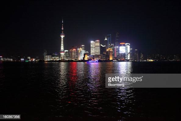 Commercial buildings in the Pudong area are seen from the Bund at night in Shanghai China on Monday Jan 28 2013 China's economic growth accelerated...