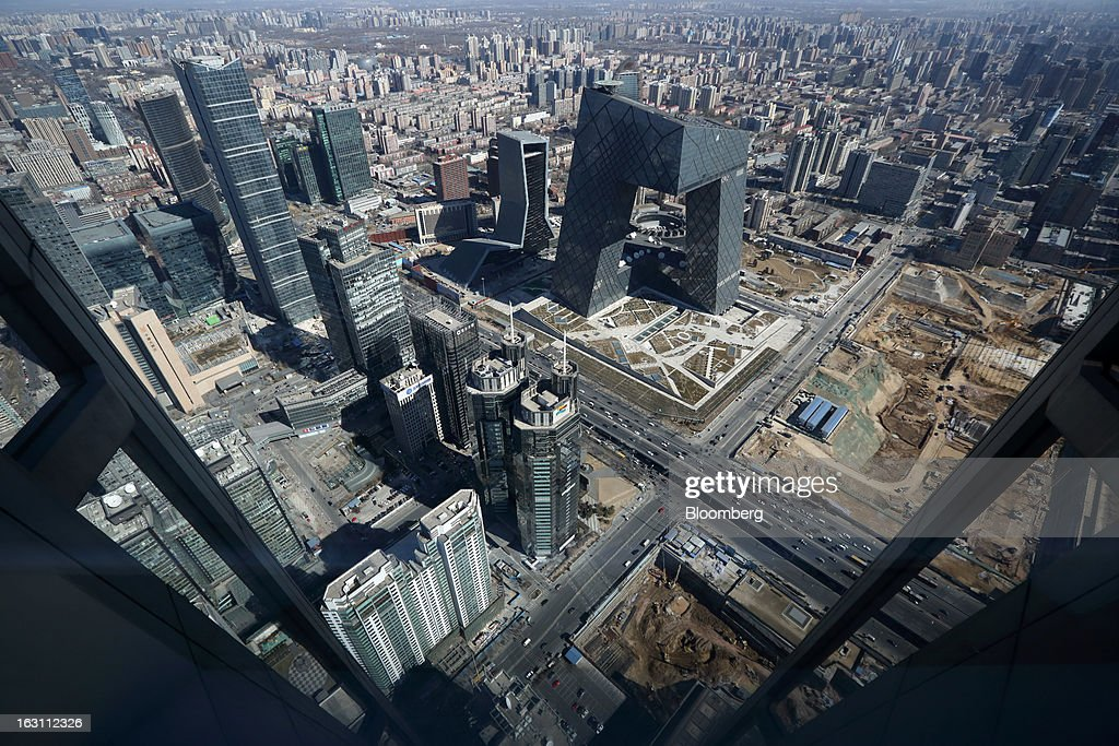 Commercial buildings including the China Central Television (CCTV) Headquarters, center right, stand in the central business district of Beijing, China, on Monday, March 4, 2013. China maintained its economic-growth target at 7.5 percent for 2013 while setting a lower inflation goal of 3.5 percent, setting up a challenge for new leaders to keep prices in check without harming expansion. Photographer: Tomohiro Ohsumi/Bloomberg via Getty Images