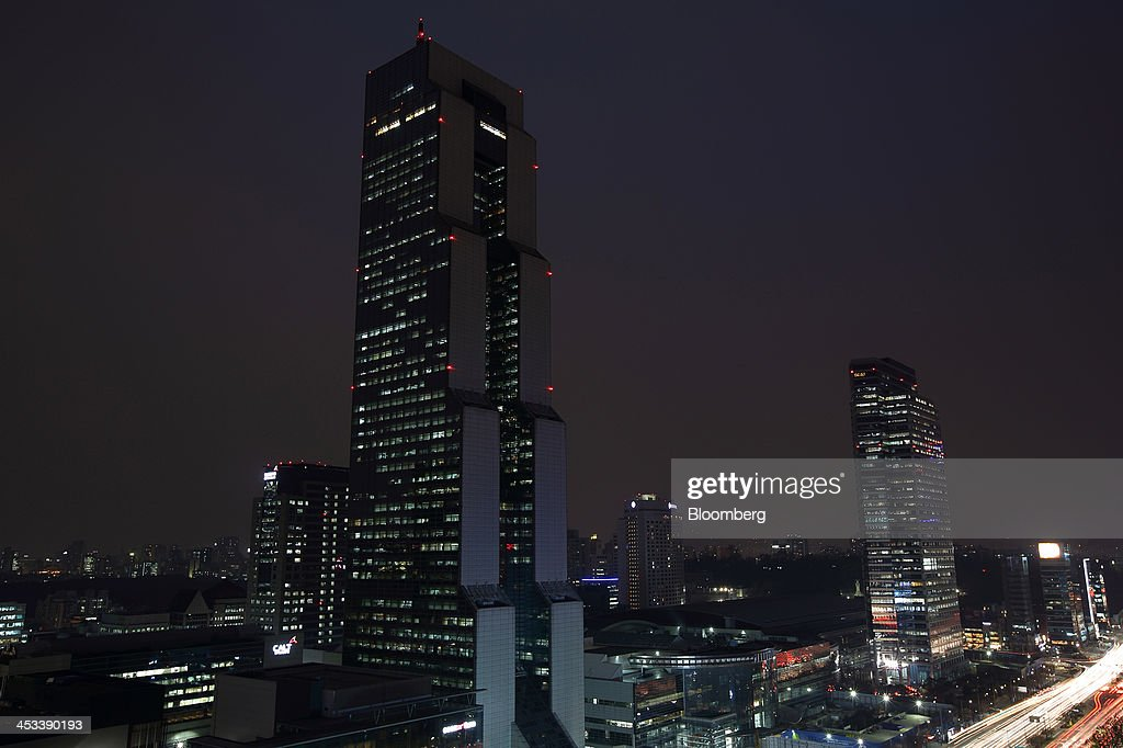 Commercial buildings stand illuminated at night in the Gangnam district in Seoul, South Korea, on Monday, Dec. 2, 2013. South Korea's economy will grow 3.9 percent next year - the fastest pace since 2010 - after a 2.8 percent expansion in 2013, the finance ministry projected in September. Photographer: SeongJoon Cho/Bloomberg via Getty Images