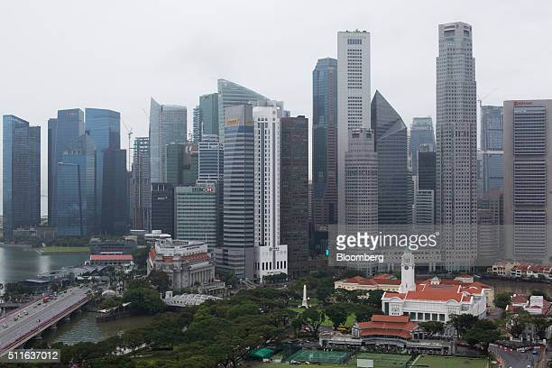 Commercial buildings stand in the central business district of Singapore on Friday Feb 19 2016 Singapore's Finance Minister Heng Swee Keat said...