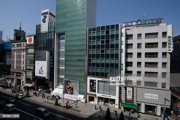 Commercial buildings stand in the Ginza district of Tokyo Japan on Monday March 20 2017 Japan's land prices will be released Tuesday evening The...
