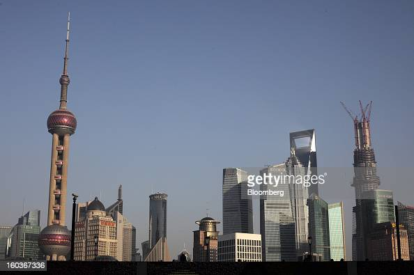 Commercial buildings stand in the Pudong area in Shanghai China on Monday Jan 28 2013 China's economic growth accelerated for the first time in two...