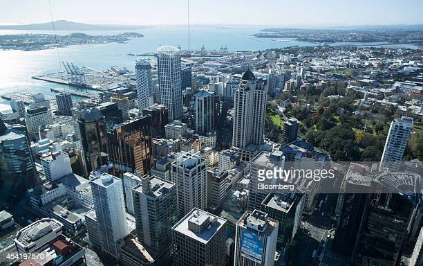 Commercial buildings stand near the Ports of Auckland terminal rear along the Waitemata Harbour in Auckland New Zealand on Friday Aug 22 2014 New...